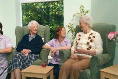 Ashcroft House staff and residents chatting in the lounge